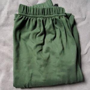 Agnes and Dora S/M solid green leggings